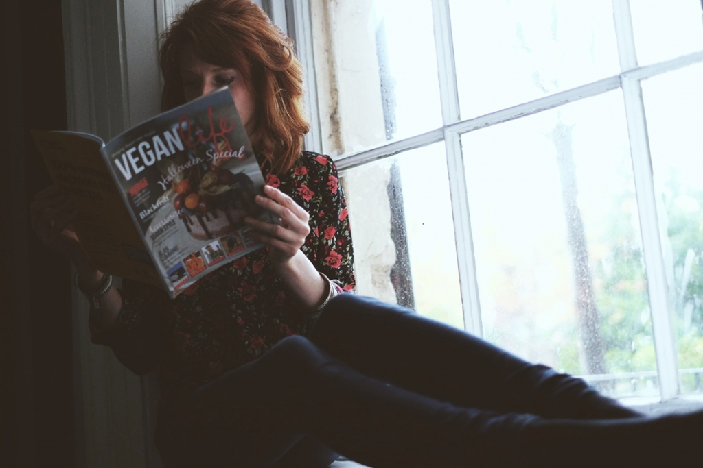 Girl reading Vegan Life mag