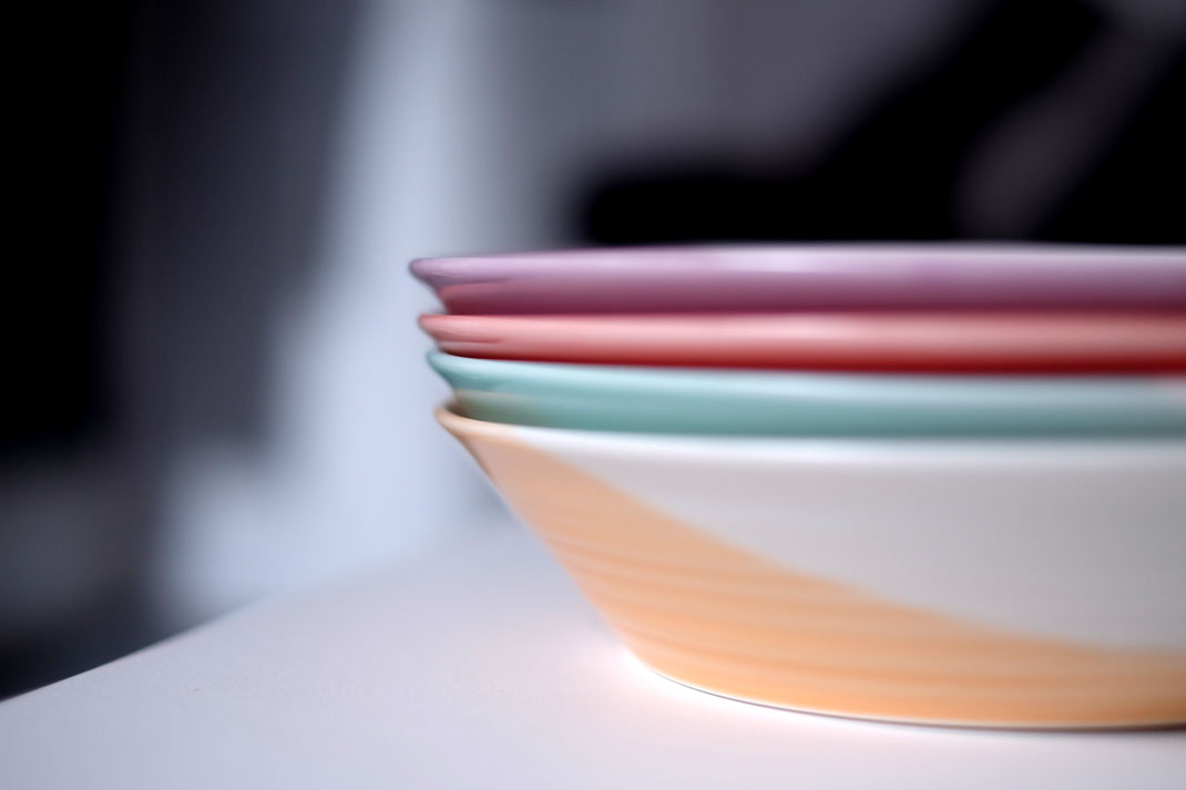 Pastel plates stacked