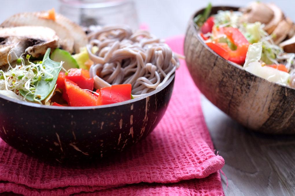 Noodle salad in coconut bowls