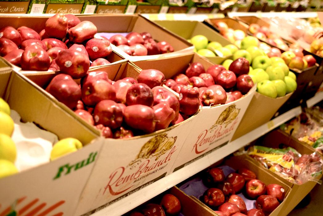 Apples in supermarket aisle