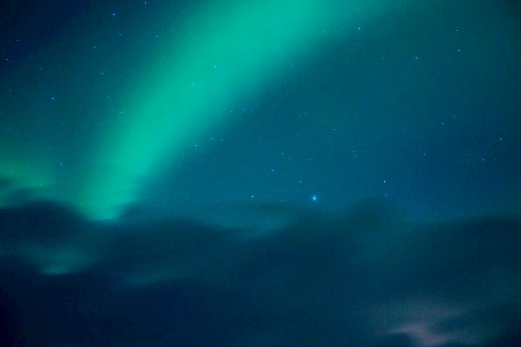 Northern Lights in cloudy sky
