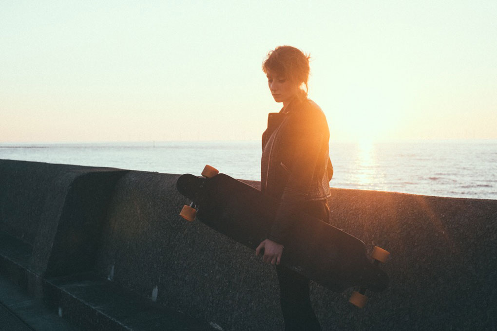 Girl carrying skateboard